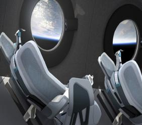 This undated photo released by Virgin Galactic shows the interior of their SpaceshipTwo Cabin during a flight. Highly detailed amenities to enhance the customer experience were shown in an online event Tuesday, July 28, 2020, revealing the cabin of the company's rocket plane, a type called SpaceShipTwo, which is undergoing testing in preparation for commercial service. (Virgin Galactic via AP)
