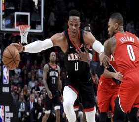 In this Jan. 29, 2020, file photo, Houston Rockets guard Russell Westbrook, left, dribbles next to Portland Trail Blazers guard Damian Lillard, right, during the first half of an NBA basketball game in Portland, Ore. (AP Photo/Steve Dykes, File).
