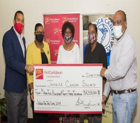 (L-R) Nigel Holness,  Managing  Director of CIBC FirstCaribbean International Bank  and Jerome Griffith, HR Manager at the bank, present the CIBC FirstCaribbean Walk For The Cure cheque for $4.5 million to Elve Passley, Administrative Assistant at the Jamaica Cancer Society (JCS); Shullian Brown, Fund Raising Officer, JCS and Michael Leslie Executive Director (Actg.) of the JCS.