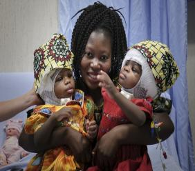 Ermine Nzotto, mother of twin girls Ervina and Prefina Bangalo, smiles following a successful surgery. (Photos: AP/Riccardo De Luca, Bambino Gesù Paediatric Hospital)