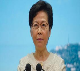 Hong Kong Chief Executive Carrie Lam listens to reporters' questions during a press conference in Hong Kong, Tuesday, July 7, 2020. TikTok said Tuesday it will stop operations in Hong Kong, joining other social media companies in warily eyeing ramifications of a sweeping national security law that took effect last week.(AP Photo/Vincent Yu)