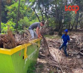 Illegal dumping offenders, Anthony Brathwaite and Ross Corbin cleaning up the Drill Hall Beach.