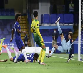 Chelsea's Olivier Giroud, on ground, scores during the English Premier League football match against Norwich City at Stamford Bridge in London, England, Tuesday, July 14, 2020. (AP Photo/Richard Heathcote,Pool).