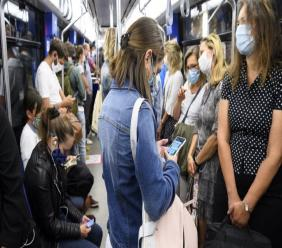"""People wearing protective mask ride the """"Transports publics lausannois"""", TL, Metro M2 (underground) during the coronavirus disease (COVID-19) outbreak, in Lausanne, Switzerland, Monday, July 6, 2020. In Switzerland, from Monday 6 July, people aged 12 and over must wear a mask in all public transport, trains, trams and buses, as well as in cable cars and boats. (Laurent Gillieron/Keystone via AP)"""
