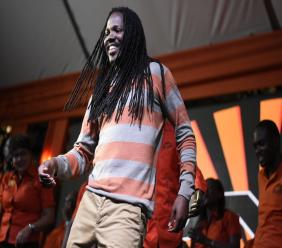 Damion Crawford dances on stage during a PNP meeting last year in Eastern  Portland.