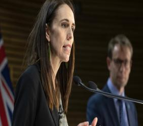 New Zealand Prime Minister Jacinda Ardern, left, and Director of Health Ashley Bloomfield address a press conference in Wellington, New Zealand, Wednesday, Aug. 12, 2020. Authorities have found four cases of the coronavirus in one Auckland household from an unknown source, the first reported cases of local transmission in the country in 102 days. (Mark Mitchell/New Zealand Herald via AP)
