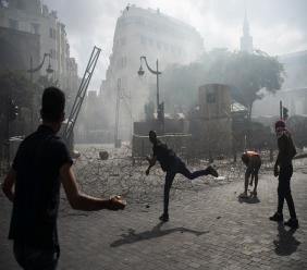 People clash with police during a protest against the political elites and the government after this week's deadly explosion at Beirut port which devastated large parts of the capital and killed more than 150 people, in Beirut, Lebanon, Saturday, Aug. 8, 2020. (AP Photo/Felipe Dana)