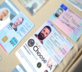 This May 4, 2020 file photo released by the Venezuelan Miraflores presidential press office shows what Venezuelan authorities identify as the I.D. cards of former U.S. special forces citizen Airan Berry, right, and Luke Denman, left, in Caracas, Venezuela.  (Miraflores Palace presidential press office via AP, File)