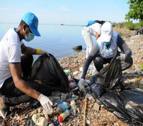 Lifespan General Manager Rodney Davis and CEO Nayana Williams lead the charge as the company mobilised volunteers to clean Sirgany Beach, along Kingston Harbour