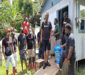 Dem Boyz members at the Jean residence