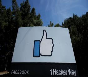 The thumbs up Like logo is shown on a sign at Facebook headquarters in Menlo Park, Calif., Tuesday, April 14, 2020.  (AP Photo/Jeff Chiu)
