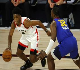 Toronto Raptors' Stanley Johnson (5) drives against Denver Nuggets' Noah Vonleh (32) during the fourth quarter of an NBA basketball game Friday, Aug. 14, 2020, in Lake Buena Vista, Fla. (Mike Ehrmann/Pool Photo via AP).