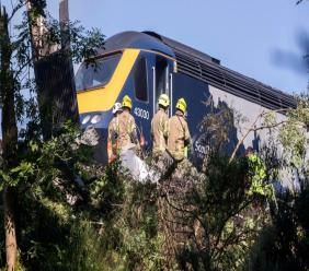 Emergency services attend the scene of a derailed train in Stonehaven, Scotland, Wednesday Aug. 12, 2020. Police and paramedics were responding Wednesday to a train derailment in northeast Scotland, where smoke could be seen rising from the site. Officials said there were reports of serious injuries. The hilly area was hit by storms and flash flooding overnight. (Derek Ironside/Newsline-media via AP)