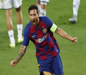 Barcelona's Lionel Messi celebrates after scoring his side's second goal during the Champions League round of 16, second leg football match against Napoli at the Camp Nou Stadium in Barcelona, Spain, Saturday, Aug. 8, 2020. (AP Photo/Joan Monfort).