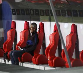 Barcelona's head coach Quique Setien sits on the bench before the start of the second half of the Champions League quarterfinal football match against Bayern Munich in Lisbon, Portugal, Friday, Aug. 14, 2020. (Rafael Marchante/Pool via AP).