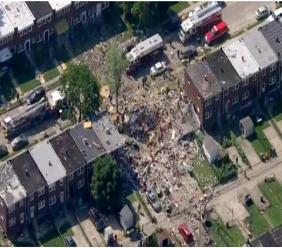 This photo provided by WJLA-TV shows the scene of an explosion in Baltimore on Monday, Aug. 10, 2020. Baltimore firefighters say an explosion has leveled several homes in the city. (WJLA-TV via AP)