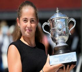 In this June 11, 2017 file photo Latvia's Jelena Ostapenko poses with the trophy during a photo call one day after winning the women's final match of the French Open tennis tournament, in Paris, France. Tennis makes a return,  with the Palermo Open, following a five-month break for the coronavirus pandemic. (AP Photo/David Vincent).