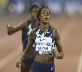 Jamaica's Elaine Thompson-Herah, wins the Women's 100m at the IAAF Diamond League in Doha, Qatar, Friday, Sept. 25, 2020. (AP Photo/Hussein Sayed).