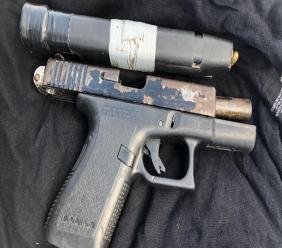 A firearm seized at the scene of a police-involved shooting in Arima.