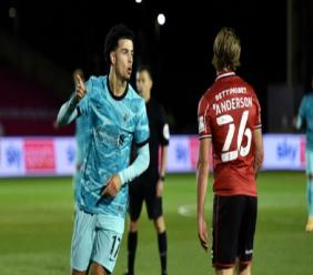 Liverpool youngster Curtis Jones (left) celebrates after scoring during the English League Cup third round football match against Lincoln City at the LNER stadium, Lincoln, England, Thursday, Sept. 24, 2020. (AP Photo/Rui Vieira, Pool).
