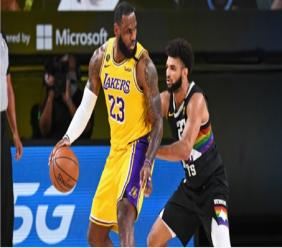 Los Angeles Lakers' LeBron James (23) holds off Denver Nuggets' Jamal Murray (27)  during their NBA conference final playoff basketball game Thursday, Sept. 24, 2020, in Lake Buena Vista, Fla.