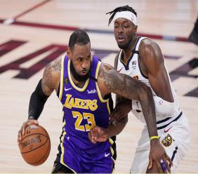 Los Angeles Lakers' LeBron James (23) drives against Denver Nuggets' Jerami Grant during the second half of an NBA conference final playoff basketball game Saturday, Sept. 26, 2020, in Lake Buena Vista, Fla. (AP Photo/Mark J. Terrill).