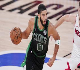 Boston Celtics' Jayson Tatum (0) plays against the Miami Heat during the second half of an NBA conference final playoff basketball game Friday, Sept. 25, 2020, in Lake Buena Vista, Fla. (AP Photo/Mark J. Terrill).