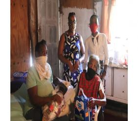 PATH Beneficiary Berly Gray (front right) with daughter Helen Gray (front left). Sharing in the occasion are  Annmarie Bassant (back left) and Toshane Young.