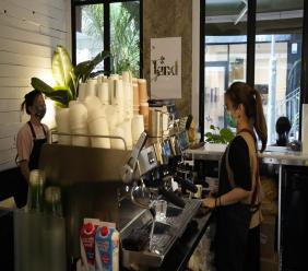 Employees work at the Found Cafe in Hong Kong after the store opened to the public. (AP Photo/Vincent Yu)