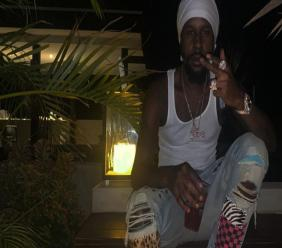 (FILE) Popcaan vacationing in Barbados during July.