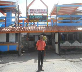 Wendell Modeste standing in front of his business