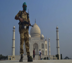 A paramilitary soldier wearing a mask stands guard as the Taj Mahal monument is reopened after being closed for more than six months due to the coronavirus pandemic in Agra, India, Monday, Sept.21, 2020. (AP Photo/Pawan Sharma)