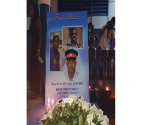A photo collage of the late police constable, Kemar Francis, on display at a candlelight vigil held in his honour on Tuesday.