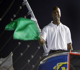 In this May 22, 2010, file photo, Charlotte Bobcats owner Michael Jordan practices waving the green flag before a NASCAR All-Star auto race at Charlotte Motor Speedway in Concord, N.C.  (AP Photo/Chuck Burton, File).