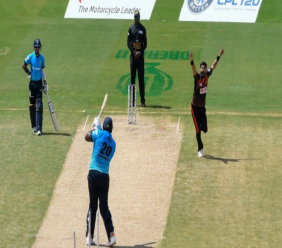 Ali Khan (right) celebrates the wicket of Rahkeem Cornwall (middle) during the 2020 Caribbean Premier League final on September 10th 2020, at the Brian Lara Cricket Academy, Tarouba. (Photo by Randy Brooks - CPLT20/Getty Images)