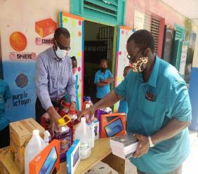 Opposition Leader Philip Pierre donates to Bishop Charles Gachet RC Primary School