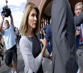 "In this August 27, 2019, file photo, actress Lori Loughlin departs federal court in Boston, after a hearing in a nationwide college admissions bribery scandal. Authorities say the ""Full House"" actress has reported to a federal prison in California to begin serving her two-month sentence for her role in the college admissions bribery scandal. The US Attorney's office in Boston said Friday that Loughlin was being processed at the federal lockup in Dublin, California. (AP Photo/Steven Senne, File)"