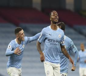 Manchester City's Raheem Sterling, front, celebrates after scoring during the English Premier League football match against Arsenal at the Etihad stadium in Manchester, England, Saturday, Oct. 17, 2020. (Martin Rickett/Pool via AP).