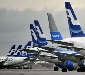 Passenger planes of the Finnish national airline company Finnair stand on the tarmac at Helsinki international airport, Helsinki. (Markku Ulander/Lehtikuva via AP, file)