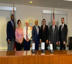 (L-R) Cabinet Secretary, Mr. Samuel Rose; Ms Celene Crance; Mr. Norman Bodden, OBE, JP; Chief Justice, Hon. Anthony Smellie, QC, JP; Premier, Hon. Alden McLaughlin, MBE, JP, Mr. James Ryan, CBE, JP and Mr. Malcolm Eden