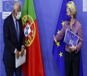 Portugal's Prime Minister Antonio Costa, left, is welcomed by European Commission President Ursula von der Leyen prior to a meeting at EU headquarters in Brussels, Thursday, Oct. 15, 2020. (Olivier Hoslet, Pool via AP)