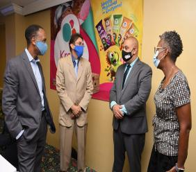 Representatives of Caribbean Cream (from left)  Wayne Wray, director;  Ryan Peralto, general manager; Christopher Clarke, chairman and Denise Douglas, company secretary converse following the company's annual general meeting at Knutsford Court Hotel on October 27.