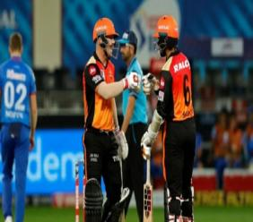 Sunrisers Hyderabad's David Warner (left) and Wriddhiman Saha touch gloves during their Indian Premier League game against  Delhi Capitals in Dubai on Tuesday, October 27, 2020. Warner (66) and Saha (87) established a fine opening partnership worth 107.