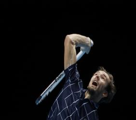 Daniil Medvedev of Russia serves the ball to Rafael Nadal of Spain during their semifinal match at the ATP World Finals tennis tournament at the O2 arena in London, Saturday, Nov. 21, 2020. (AP Photo/Frank Augstein).