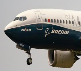 In this September 30, 2020, file photo, a Boeing 737 Max jet, piloted by Federal Aviation Administration Chief Steve Dickson, prepares to land at Boeing Field following a test flight in Seattle.(AP Photo/Elaine Thompson, File)