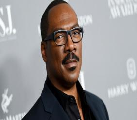 """Honoree actor-comedian Eddie Murphy attends the WSJ. Magazine 2019 Innovator Awards in New York on November 6, 2019. """"Coming 2 America,"""" the sequel to the 1988 Eddie Murphy comedy, has landed on a date to come to audiences. Amazon Studios announced Friday that the film which reunites Murphy and Arsenio Hall will debut on Amazon Prime Video on March 5, 2021. (Photo by Evan Agostini/Invision/AP, File)"""