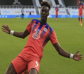 Chelsea's Tammy Abraham celebrates after scoring his side's second goal during the English Premier League football match against Newcastle United at the St. James' Park in Newcastle, England, Saturday, Nov. 21, 2020. (Lindsey Parnaby/ Pool via AP).