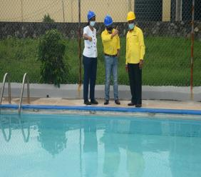 (From left) Suzanne Harris-Henry, General Secretary of JPA; Winfield Boban, Managing Director, Surgix Prosthetic Clinic and Christopher Samuda, President, JPA examine the repair work being done by Surgix on the JPA  swimming pool at the Mona Rehab Centre.