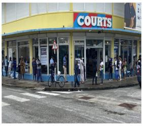 Long lines formed outside Courts Barbados in George Street, Bridgetown on Black Friday.