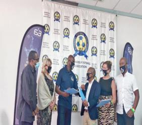Emmerson Boyce and his team at the MOU signing with BFA President Randy Harris and NSC Director Neil Murrell